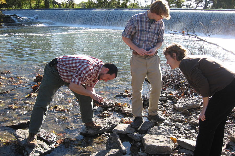 Students standing in a stream bed