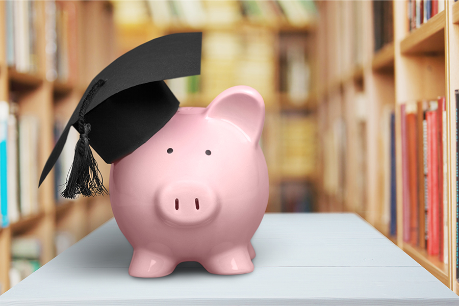 Piggy Bank wearing a mortarboard