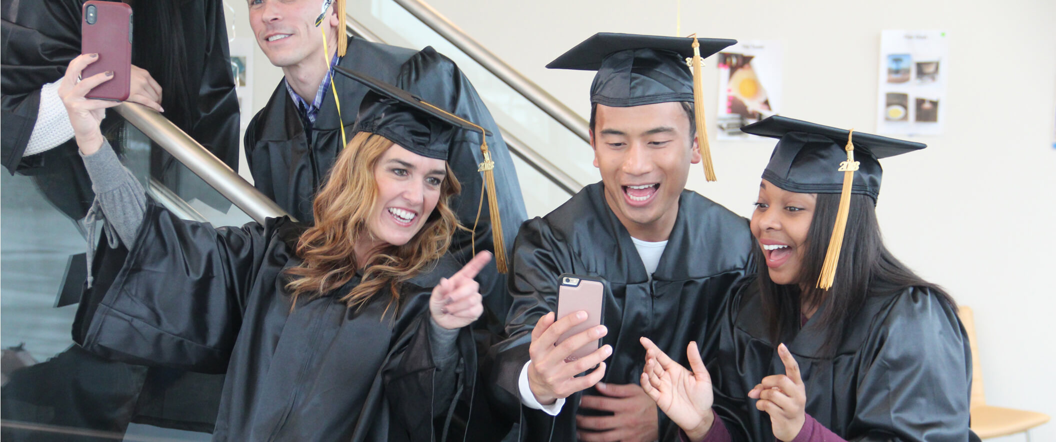 students on graduation day taking selfies