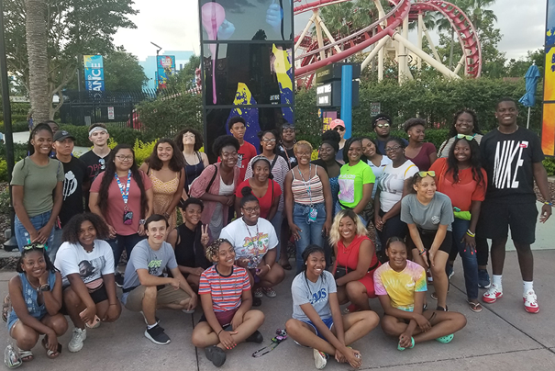 Group of students at amusement park with upward bound