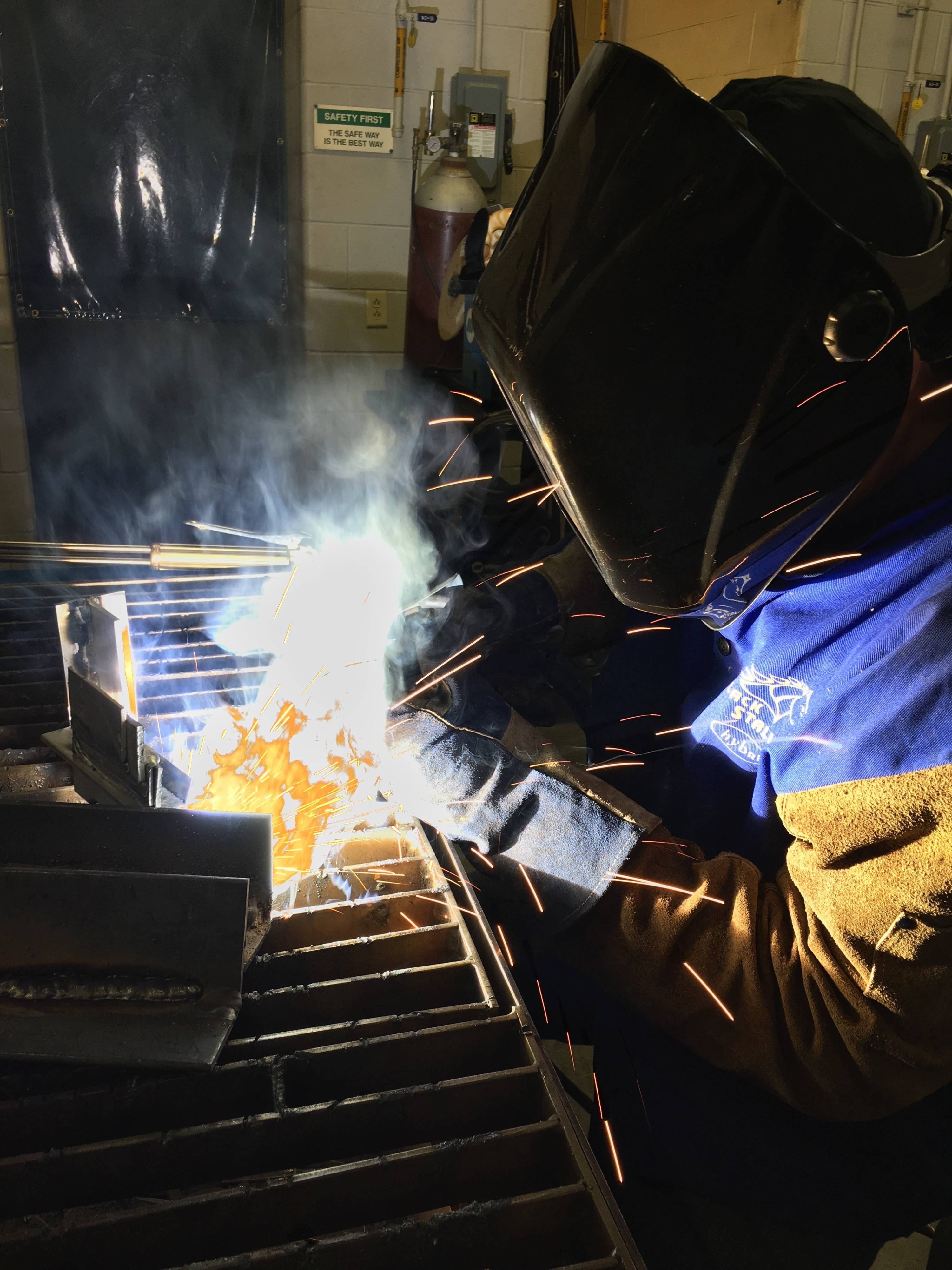 Photo of a person welding