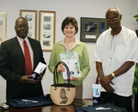 Photo of Phillip Owuor, Dr.Augusta A. Julian, and John Agure