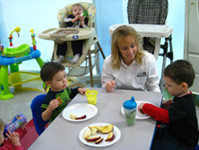 Photo of Rebecca Biddle and Children from the Day Care