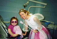Photo of the Tooth Fairy and a Child