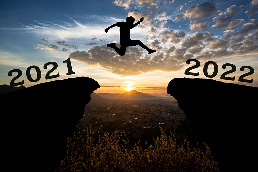 person jumping over ledge with 2021 and 2022 on either side