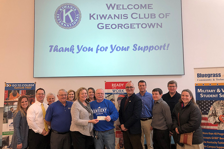 Lynn Godsey, Marvin Thompson, and Dr. Greg Feeney with Kiwanis Georgetown Members